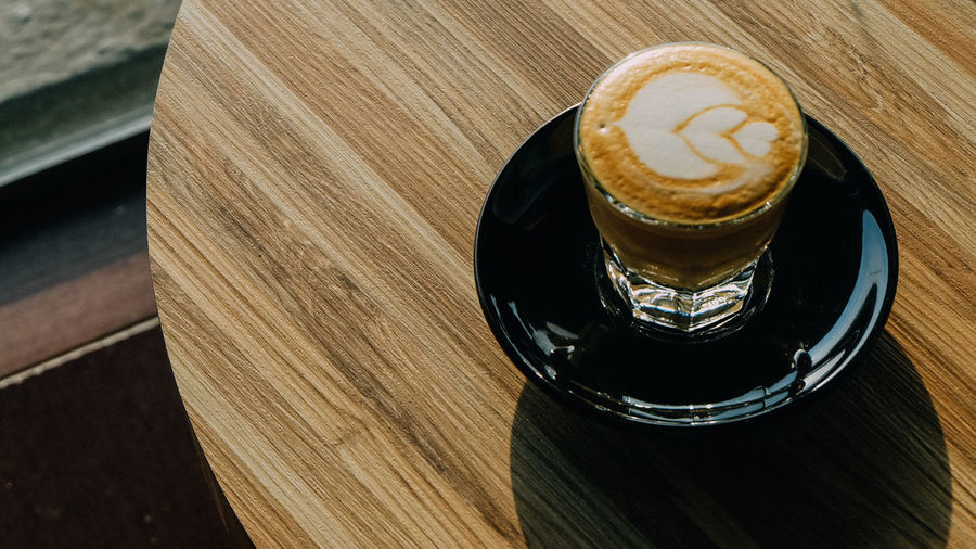 Latte Close-up Coffee - Drink Coffee Cup Day Drink Food And Drink Freshness High Angle View Indoors  No People Refreshment Table Wood - Material