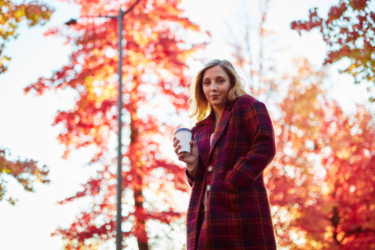 Autumn Beautiful Woman Beauty In Nature Change Day Focus On Foreground Leaf Leisure Activity Lifestyles Long Hair Looking At Camera Low Angle View Nature One Person Outdoors Park - Man Made Space People Portrait Real People Scarf Standing Tree Young Adult Young Women