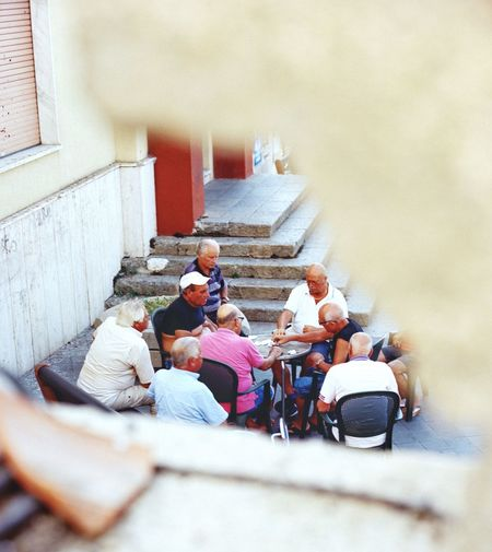 The game Calabria Filmphotography Italy EyeEm Group Of People Real People Architecture Men Women Day Lifestyles Togetherness Group People Sitting High Angle View