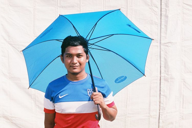 man with blue umbrella Asian  Bangladesh EyeEmNewHere Pakistan Evening People Sky Teenager Umbrella