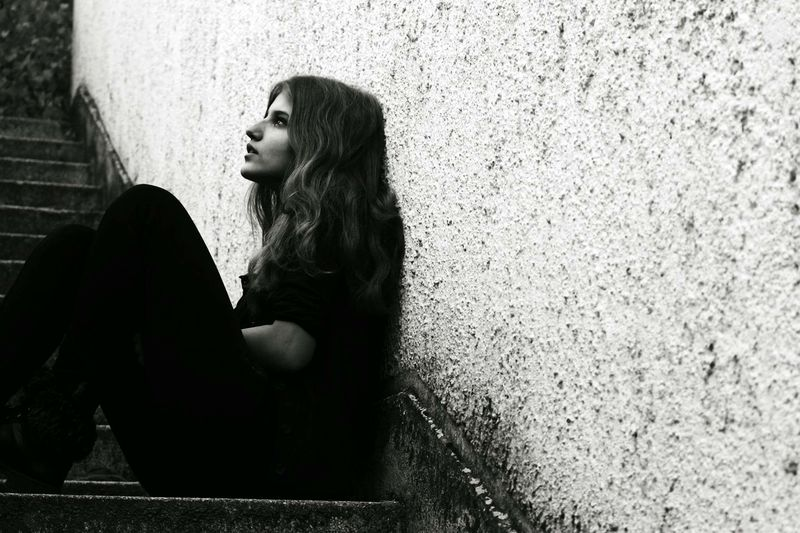 Young Adult Long Hair Lifestyles Young Women Wall - Building Feature Standing Casual Clothing Three Quarter Length Person Architecture Contemplation Thoughtful Beautiful People Monochrome Photography Black And White Blackandwhite Stairs Architecture Portrait Thinking