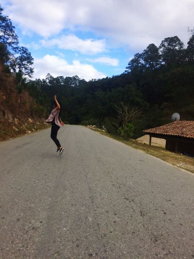 Full Length Sky Energetic One Person Lifestyles Road Cloud - Sky Real People Outdoors Day Nature Tree Young Adult People