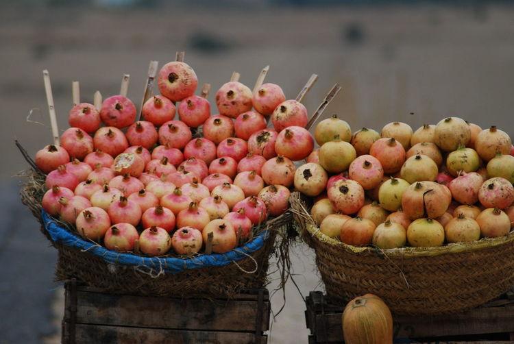 Pomegranates In Basket For Sale At Market