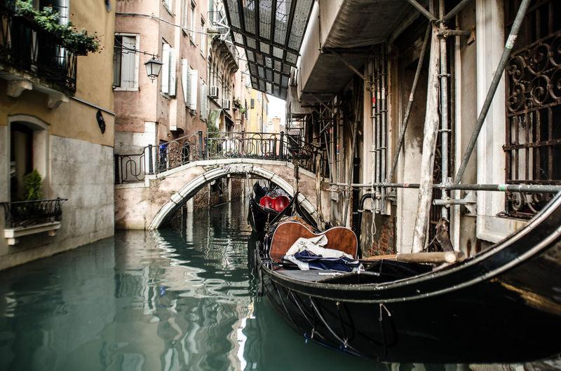 Man on bridge over canal