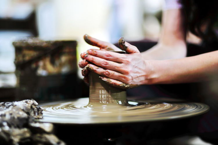 The activity clay pot uses hand workshop mold Ancient Thailand. Adult Ceramics Close-up Creativity Design Dirt Education Finger Focus On Foreground Hand Human Body Part Human Hand Indoors  Making Motion Mud One Person Pottery Preparation  Selective Focus Skill  Spinning Vintage Working