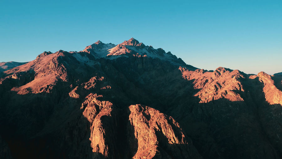Scenic view of mountain range against clear sky