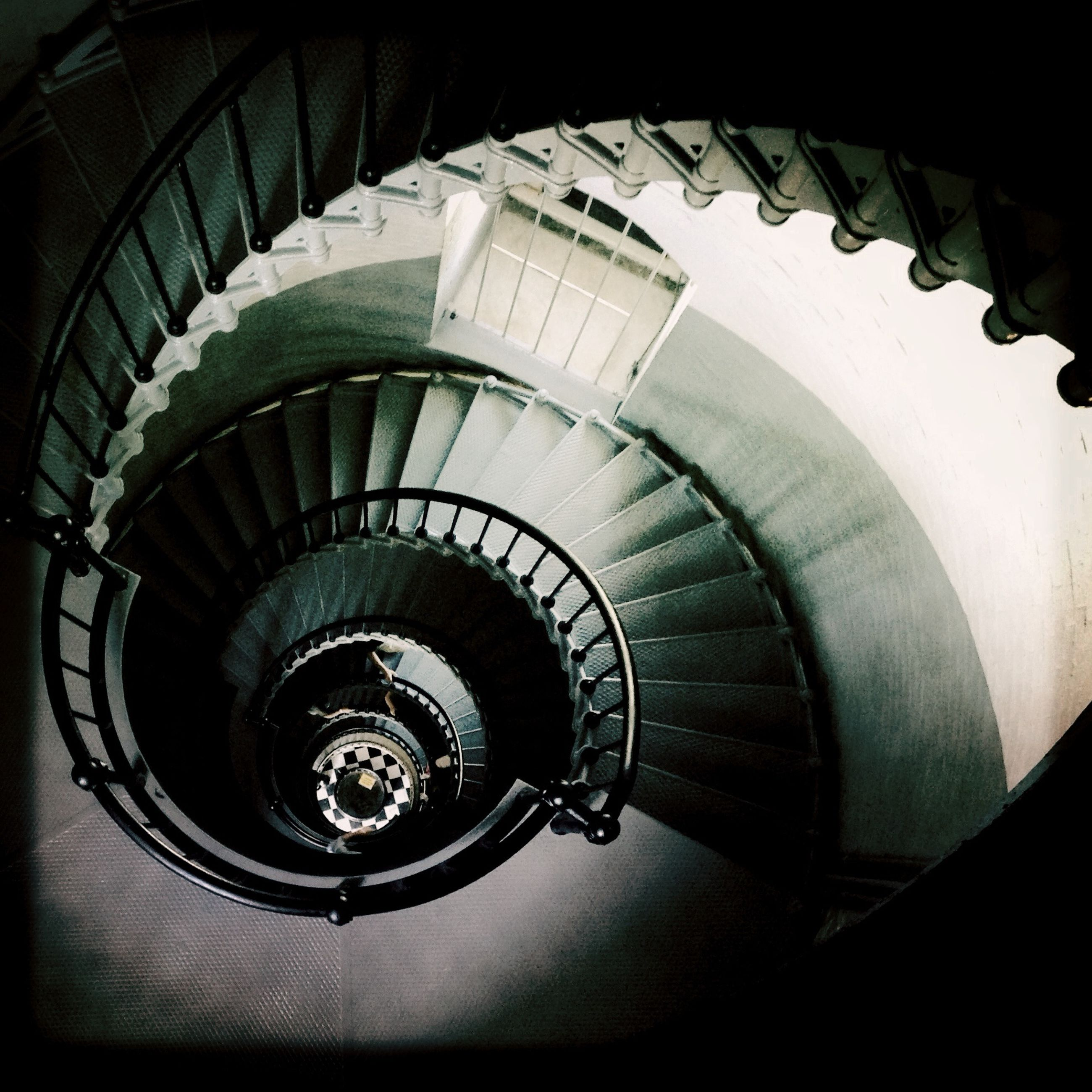 staircase, indoors, steps and staircases, steps, architecture, built structure, spiral staircase, spiral, railing, low angle view, building exterior, building, circle, high angle view, directly below, pattern, stairs, modern, no people, arch