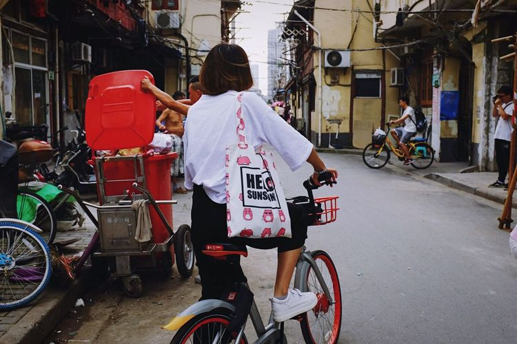 Bicycle Transportation Mode Of Transport City Life Land Vehicle City Street City Street Architecture Building Exterior Built Structure Real People Riding Cycling Men Outdoors Day Motorcycle Adult Adults Only EyeEmNewHere Shanghai Streets Cityscape The Week On Eyem Peoplephotography