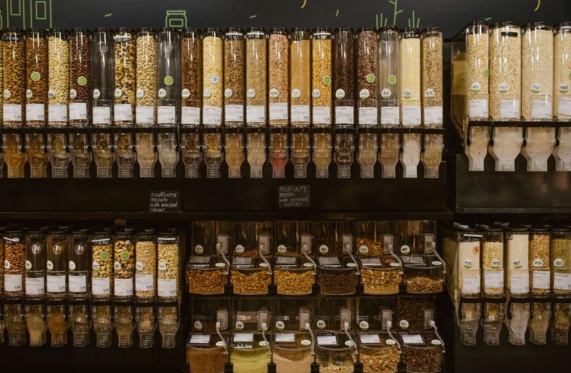 Full frame shot of food in glass bottles for sale at market