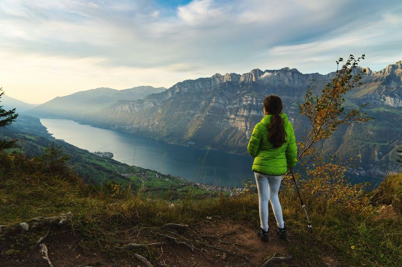 Mountain Rear View Real People One Person Beauty In Nature Nature Full Length Women Lifestyles Leisure Activity Sky Scenics Mountain Range Cloud - Sky Standing Tranquility Landscape Water Day Outdoors