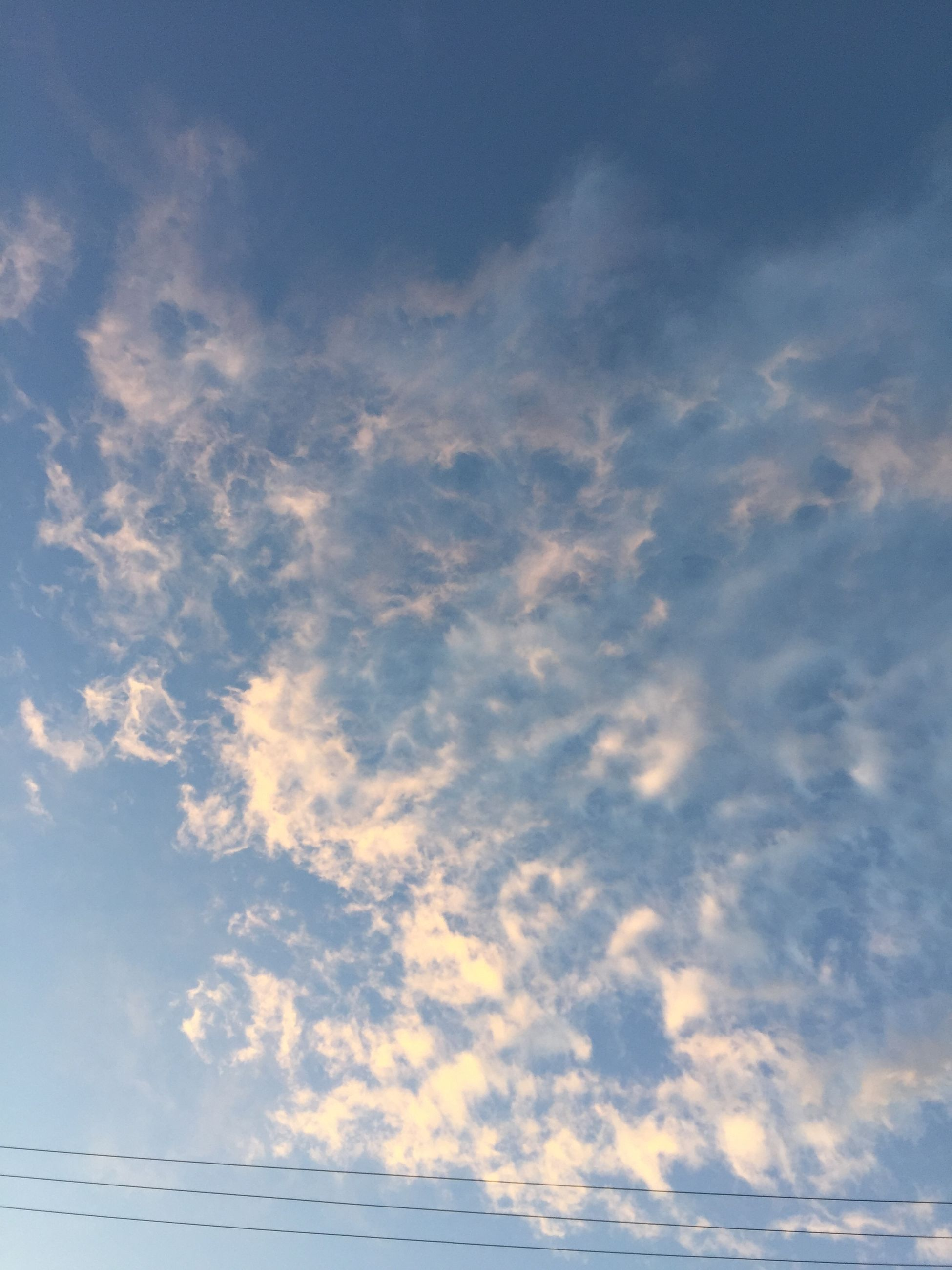 sky, low angle view, cloud - sky, beauty in nature, tranquility, cloudy, scenics, blue, nature, cloud, tranquil scene, backgrounds, sky only, cloudscape, full frame, idyllic, outdoors, no people, day, white color