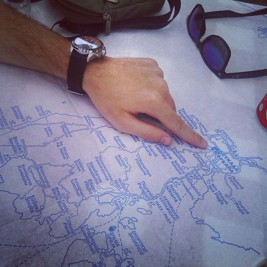 studying the map while waiting for KINGSIZE gyros Greece Lefkada Lefkas Summer 2014