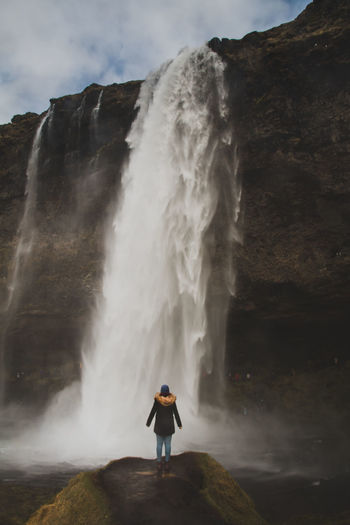 seljalandsfoss - iceland Adventure Beauty In Nature Cliff Day Full Length Landscape Leisure Activity Motion Mountain Nature One Person Outdoors People Power In Nature Real People Rear View Rock - Object Scenics Seljalandsfoss Sky Standing Travel Destinations Travel Photography Water Waterfall The Great Outdoors - 2017 EyeEm Awards