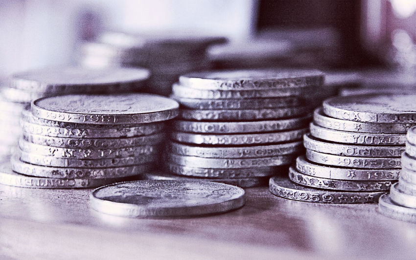 wealth concept, silver coins piled up, blurred background Cash Close-up Coin Concept Currency Economy Finance Heap Indoors  Investment Luck Money No People Profit Savings Silver Coins Silver Colored Stack Success Wealth