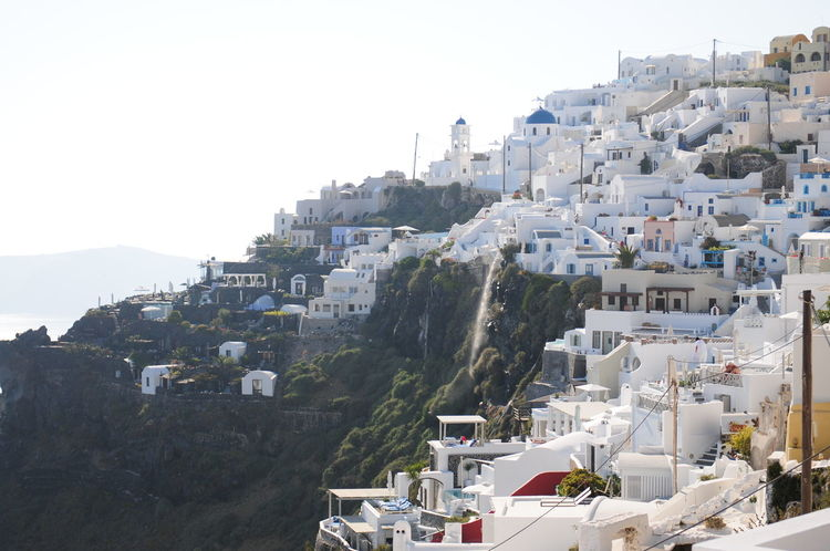 Santorini, Greece Architecture Building Exterior Built Structure City City Life Clear Sky Crowded Day Greece House Mountain No People Out Outdoors Residential Building Residential District Residential Structure Santorini Scenics Sea Sky Tourism Town Travel Destinations View