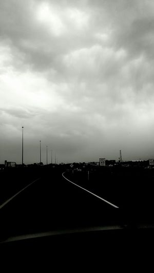 Taken On Mobile Device Taken By M. Leith Black And White In The Car Driving Mein Automoment Expressive Sky Storm Streetphotography Street Photography Monochrome