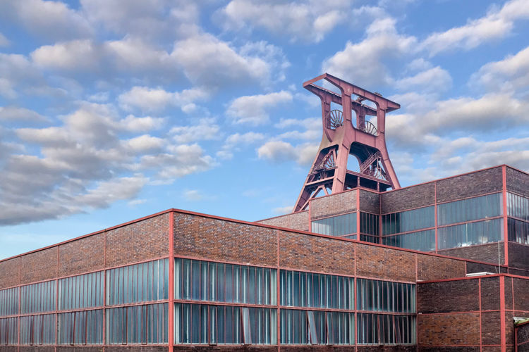 Built Structure Architecture Sky Cloud - Sky Building Exterior Day Nature Low Angle View Building No People Outdoors Industry Factory Metal High Section Tower Blue Red Window Sunlight