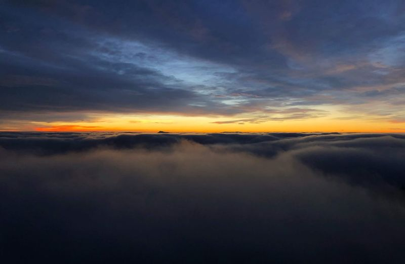 Sunset above the clouds Cloud - Sky Sky Sunset Scenics - Nature Beauty In Nature Tranquility Tranquil Scene Non-urban Scene Orange Color Dramatic Sky Nature Reflection Waterfront Water Idyllic No People Outdoors Sea