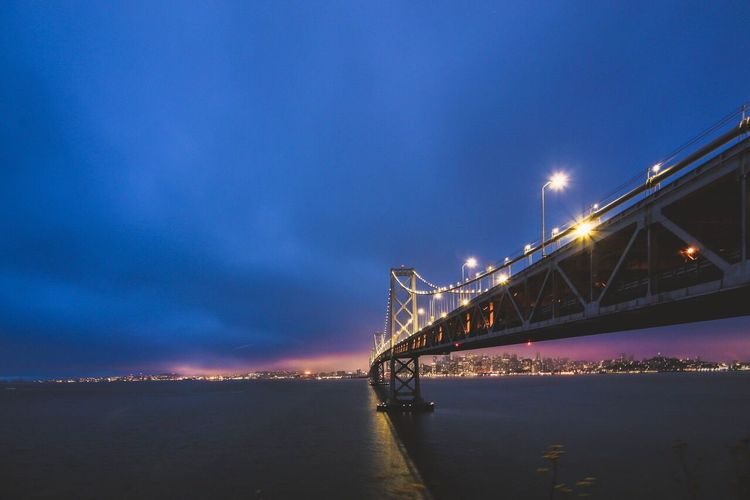 Illuminated oakland bay bridge at night