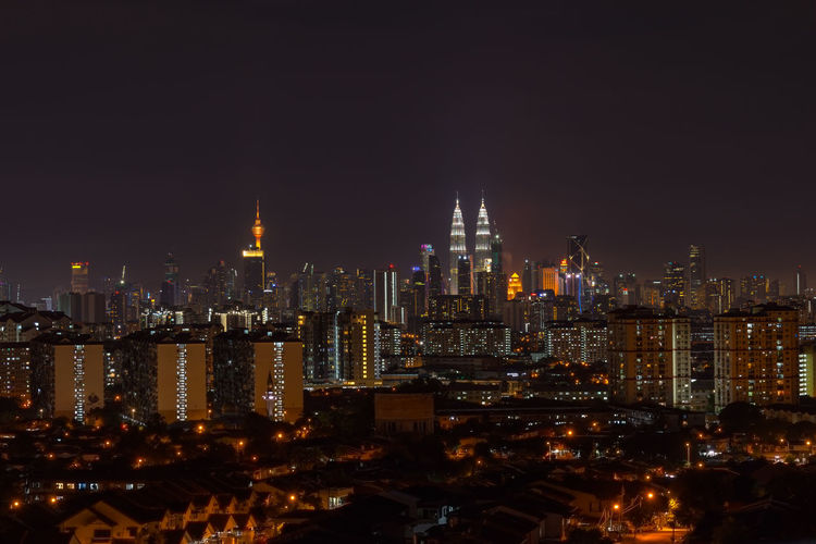 KUALA LUMPUR, MALAYSIA - 24TH FEBRUARY 2017; Kuala Lumpur, the capital of Malaysia. Its modern skyline is dominated by the 451m-tall KLCC, a pair of glass-and-steel-clad skyscrapers. Foggy Day KLCC Twin Towers Kuala Lumpur Malaysia  Kuala Lumpur Tower Kuala Lumpur Twin Tower Model Neon Lights Petronas Twin Towers Skyline Tarmac