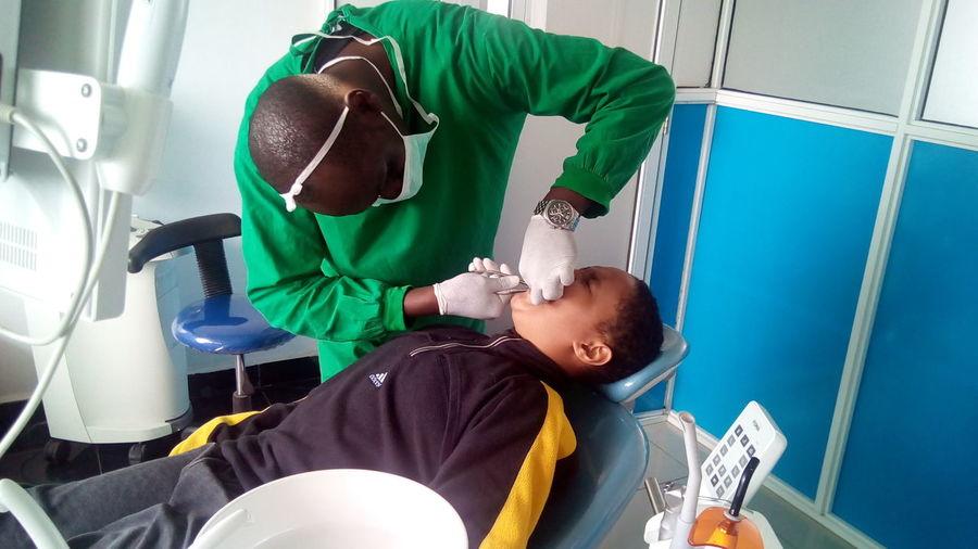 dental checkup Dentist Dentistry EyeEm Selects Men Teamwork Headwear Protective Glove Exercising Mid Adult Men Occupation Healthcare And Medicine