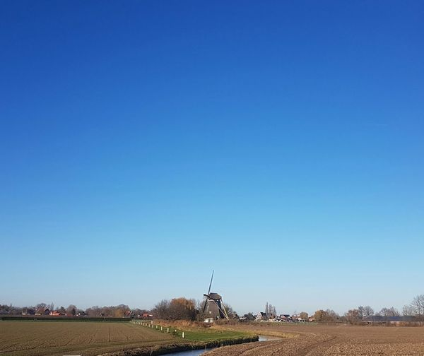 Blue Clear Sky No People Sky Nature Outdoors Day Tourism Travel Destinations Vacations Travel Scenics Nature Landscape Rural Scene Sunset Tree Tranquil Scene Beauty In Nature Netherlands Windmill windmills photographyWindmill Of The Day Windmill Photography Holland