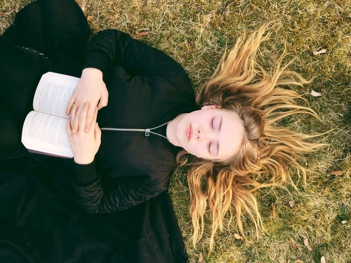 Relaxing in the park Grass Blond Hair One Person Portrait Leisure Activity Lying Down Outdoors Day Real People People Relaxing Relaxation Park Reflection Thoughts Peaceful The Portraitist - 2018 EyeEm Awards This Is Natural Beauty