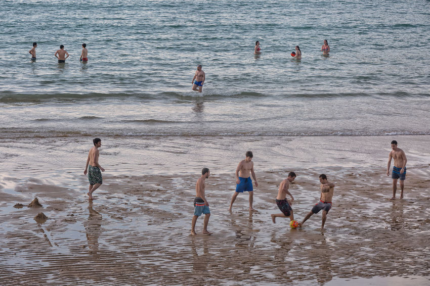 People taking advantage of the low tide to have fun. Adult Adults Only Aquatic Sport Beach Child Day Large Group Of People Men Nature Outdoors People Playing Real People Sea Sport Swimming Teamwork Water Wave Women Young Adult