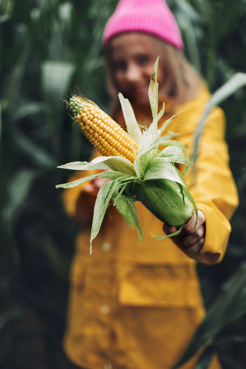 Close-up of person holding yellow leaf