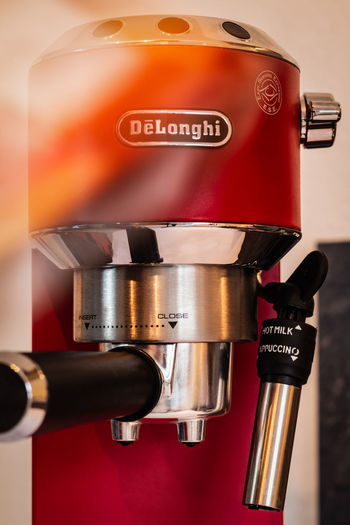 Text Indoors  Close-up Appliance Coffee Maker Communication Red Western Script No People Metal Food And Drink Still Life Machinery Equipment Silver Colored Technology Fuel And Power Generation Shiny Coffee Convenience