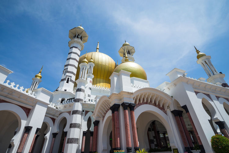 Low angle view of ubudiah mosque against sky