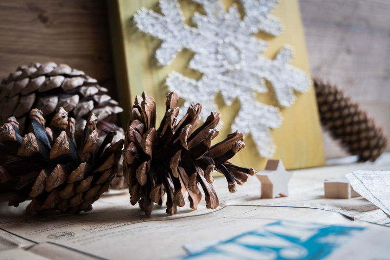 Close-Up Of Pine Cones And Christmas Decorations On Table