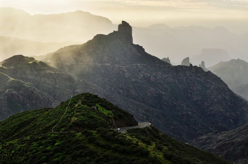 mountain peaks on gran canaria canary island in spain Island Gran Canaria Canary Fog Cloud Mist Peak Top Evening EyeEm Selects Mountain Fog Nature Outdoors No People Travel Destinations Mountain Range Landscape Day Winter Vacations Beauty In Nature Scenics Sky An Eye For Travel Go Higher