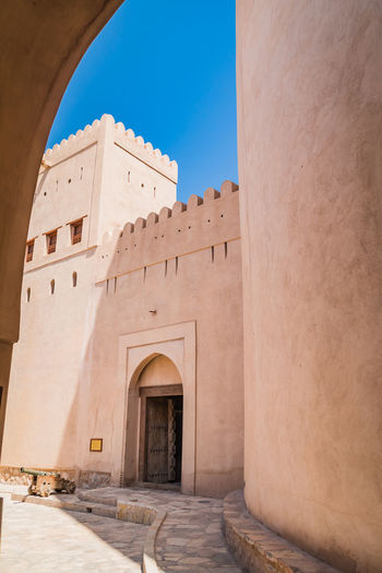 Ancient Civilization Arabic Arch Architecture Building Exterior Built Structure History Nizwa Fort Oman Outdoors Travel Travel Destinations Travel Photography