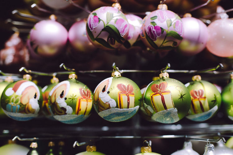 Close-up of christmas decorations hanging indoors