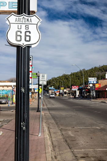 Things to See on Route 66, Williams, Arizona Sign Transportation Communication Sky City Cloud - Sky Street Road Mode Of Transportation Incidental People Nature Guidance Text Symbol Day Direction Road Sign Western Script Motor Vehicle Information Outdoors