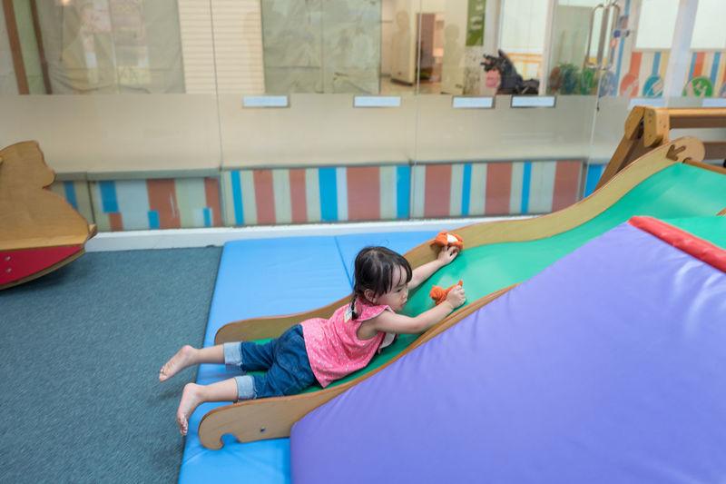 Full length of girl on slide