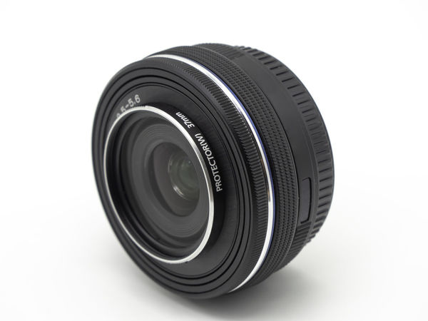 Camera photo lens. Lens digital camera close up isolated on white background. Photography Themes White Background Lens - Optical Instrument Camera - Photographic Equipment Technology Studio Shot Cut Out Single Object Indoors  Close-up Photographic Equipment Lens - Eye Still Life No People Circle Geometric Shape Camera Black Color Focus On Foreground Shape Digital Camera Silver Colored