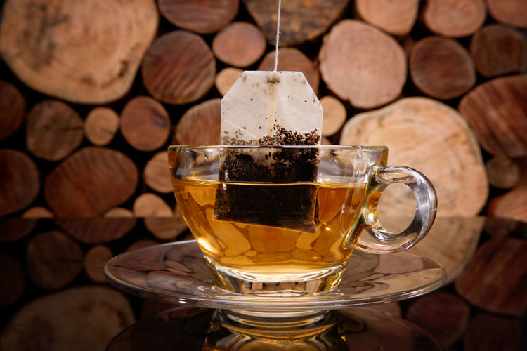 Hot tea cup with tea bag on a wooden background. Beverage Breakfast Herb Morning Sugar Aroma Close-up Coffee - Drink Day Drink Drinking Drinking Glass Food Food And Drink Freshness Frothy Drink Healthy Eating Healty Indoors  Leaves No People Organic Refreshment Relax Table