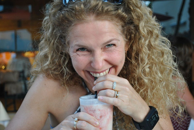 Blond Hair Cafe Close-up Curly Hair Drink Drinking Drinking Glass Drinking Straw Focus On Foreground Food And Drink Front View Happiness Headshot Healthy Eating Holding Indoors  Lifestyles Looking At Camera Milkshake One Person Portrait Real People Refreshment Smiling Young Adult