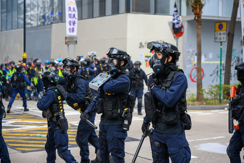 Police force standing on street