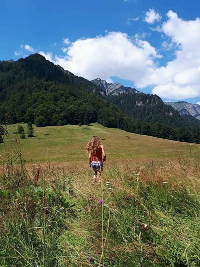 Looking for the summer! Holiday Trip Mountains And Sky Sky And Clouds Lawn Grass With Flower Woman Who Inspire You Woman Walking Grass Area Colors Of Nature Popular Photo Outdoors Photograpghy  Full Length Wildflower Uphill