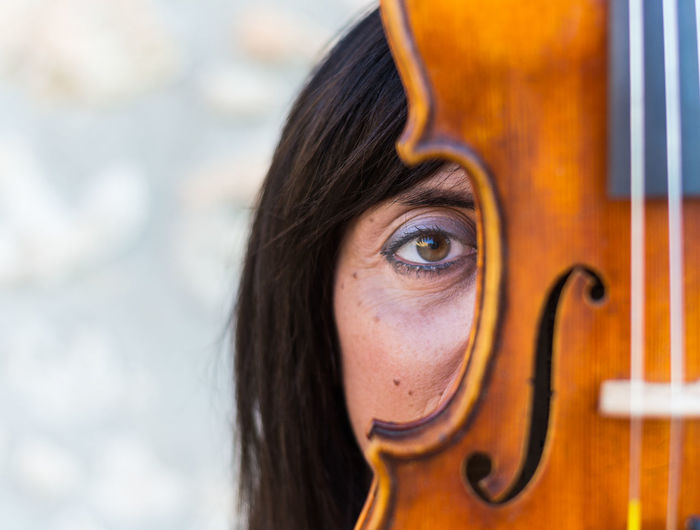 Close-Up Portrait Of Woman With Violin