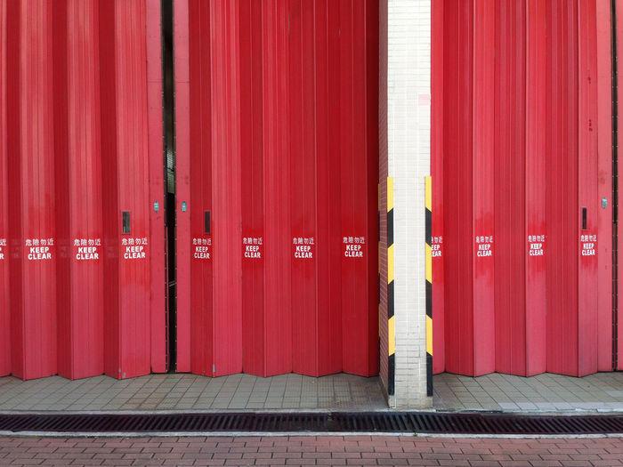 Close up of a big red folding door