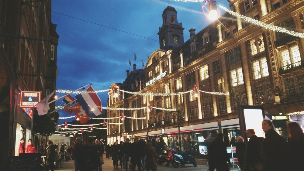 Starting to feel the Christmas spirit in Amsterdam. Nightlife Night Tourism Travel Destinations City Building Exterior Architecture Sky Neon Lights Christmas Lights Bijenkorf Amsterdam Netherlands The Netherlands Central Holland Flag Colors