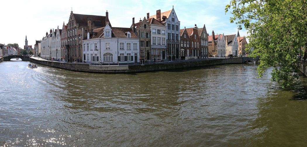 Bruges, Belgium - July 7, 2017: Panoramic view of one of the several canals in the center of Bruges, Flanders in Belgium Beer Belgium Brugge Chocolate Dijver Canal Duvel Flanders Panoramic View Provinciaal Hof West Flanders Aerial View Belfry Tower Bikes Bruges Europe Flower French Fries Holland Market Square Medieval Town Mussels