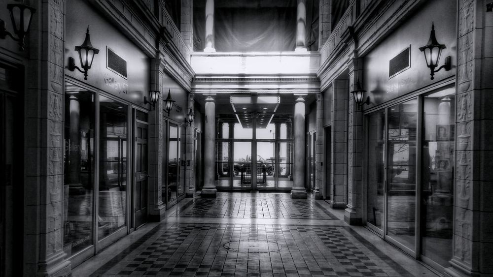 The Arcade Mall Entryway (wide, in Black And White) – Columbia's first shopping center, built in 1912 – is about to get a face-lift... read more here: http://www.thestate.com/news/business/article56317810.html -- Telling Stories Differently Blackandwhite Black&white Black & White Noir Et Blanc Noiretblanc Architecture Architecture_bw Architecture_collection Indoor Architecture Interior Design IndoorPhotography Indoor Photography Chandelier Light And Shadow Shadows Shadow Shades Of Grey Shapes EyeEm Best Shots - Architecture Building Building Interior Built Structure The Architect - 2016 EyeEm Awards