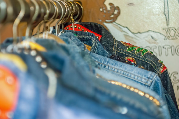 Denim Jackets Hanging On Clothes Rack