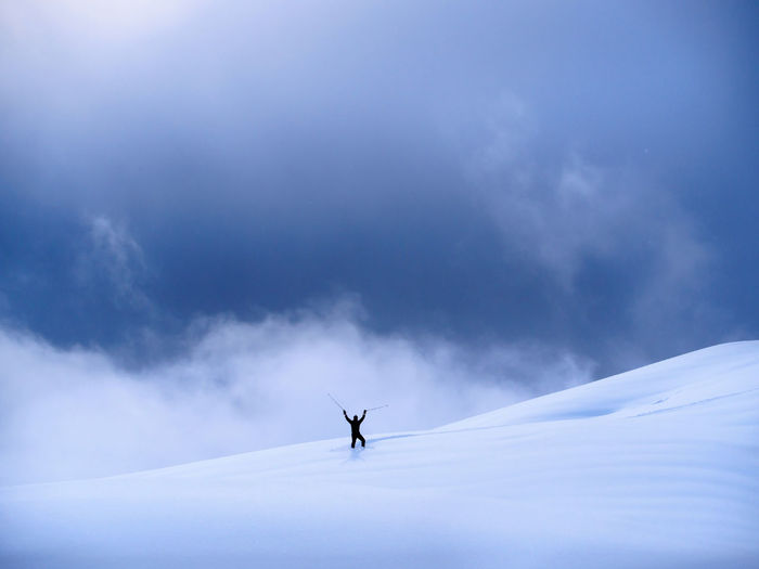 Man on snow against sky