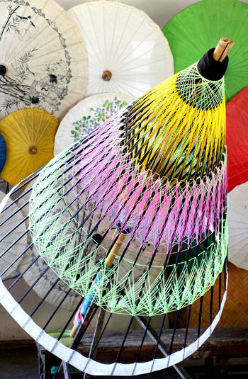 Structure of umbrella made of bamboo are handicraft in Thailand. Art And Craft Craft Handmade Handicraft Indigenous  Umbrella Colorful Color Thailand Thai Travel Health Healthcare Lifestyle Lifestyle People Summer Holiday Recreation  Relax Rainy Season Structure Rope Multi Colored Fanned Out Close-up Male Likeness Human Representation Sculpture Craft Product Statue